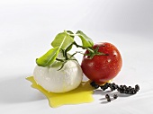 Tomato, mozzarella and basil with olive oil and pepper