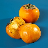 Whole and halved kaki persimmons