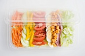 Mixed salad with ham and egg in a plastic tray