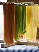 Coloured pasta hanging up to dry