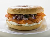 Salmon, cream cheese, onions and capers in a bagel