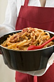 A pot of macaroni with meat and tomato sauce