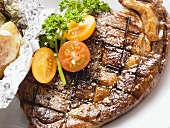 Grilled rump steak with tomatoes and baked potato