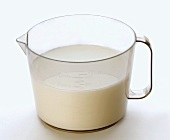 Fresh milk in a measuring jug