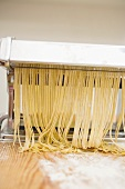 Home-made tagliatelle in pasta maker