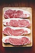 Sirloin steaks on wooden board