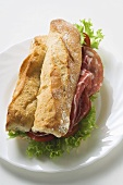 Sub sandwich with raw ham on a plate