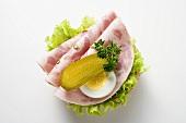 Bierschinken (ham sausage), gherkin and egg on half a roll