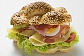 Ham, salami, cheese and egg sandwich