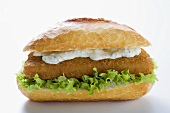 Fish burger with remoulade and lettuce