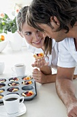 Young couple tasting a fresh fruit tart