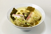 Sauerkraut soup with lotus root and fish