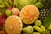 Carved melons among mixed fruit