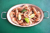 Cooked prawns with sea salt and lime wedges