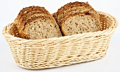 Sliced mixed-grain bread in a bread basket