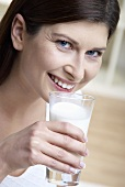 Woman holding a glass of milk in her hand