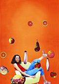 Woman sitting in chair surrounded by flying fruit & vegetables