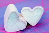 Two pink and white marshmallow hearts