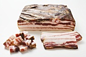 Smoked belly bacon, a piece, slices and diced