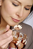 Woman eating chocolate ice cream sundae