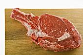 A rib-eye steak on a wooden board