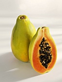 Whole and half papaya, standing