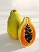 Whole and half papaya, standing