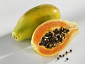 Whole and half papaya, lying