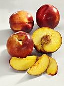 Nectarines, whole, half and slices