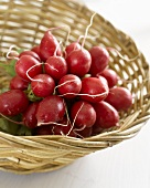 A bunch of radishes in a basket