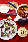 Meat fondue with broth and a selection of dips