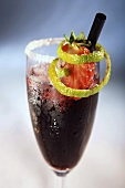 Sangria in sparkling wine glass with sugared rim
