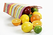 Split paper carrier bag of citrus fruit