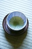 Bowl of green Matcha tea