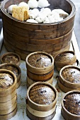 Steaming baskets and various types of Chinese dumplings