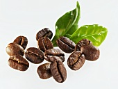 Roasted coffee beans with leaves