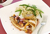 Roast chicken breast with peach and cranberry sauce