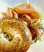 Poppy seed bagel filled with smoked salmon