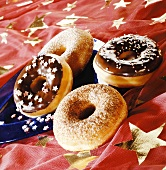 Four doughnuts on a star-patterned cloth
