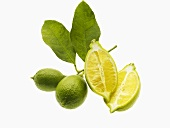 Halved lemon and two limes with stalk and leaves