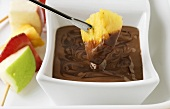 Chocolate fondue with skewered fruit