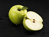 Whole and half 'Granny Smith' apple