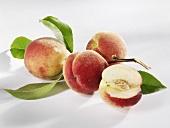 Four white peaches