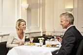 Man and woman having a meal in a restaurant