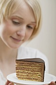 Young woman with a piece of cake