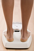 Young woman on bathroom scales