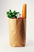 A brown paper bag full of groceries
