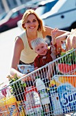 Mother and son food shopping with shopping trolley