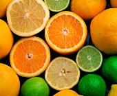 Citrus fruits: lemon, lime and orange (filling the image)