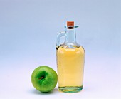 Cider vinegar and an apple